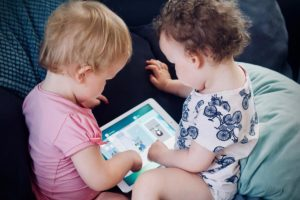 two baby using tablet