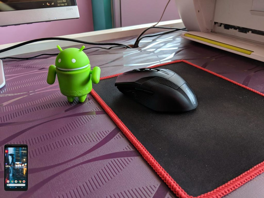 Android Toy Near Computer Mouse