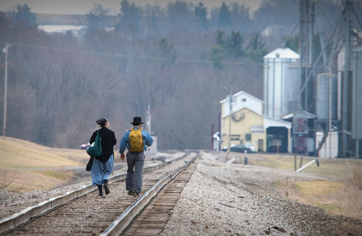 Two person walking in track