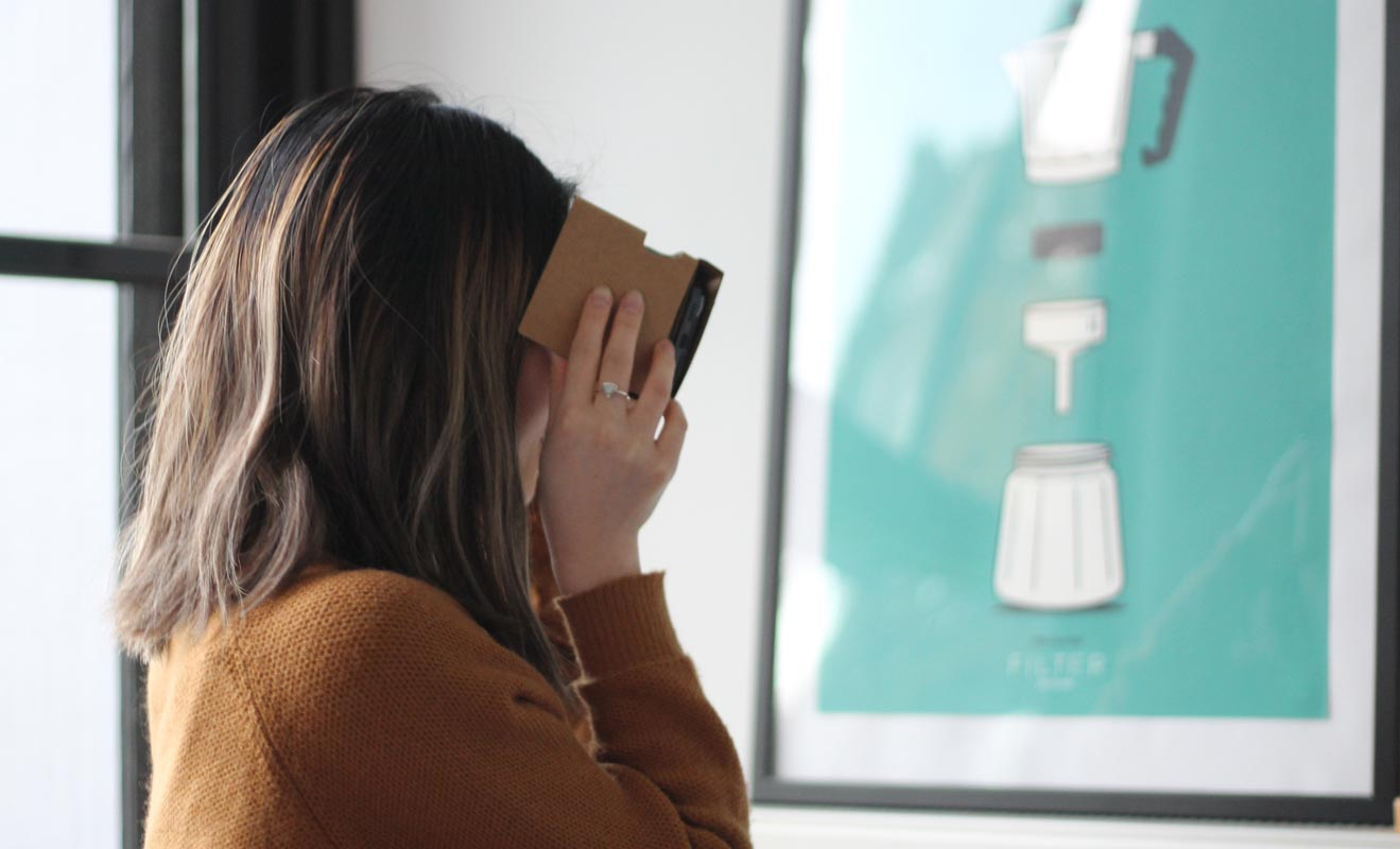 Woman using Google Cardboard VR