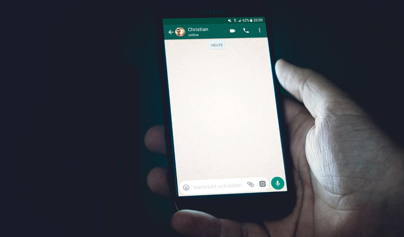 Whatsapp Chat on Mobile in Hand
