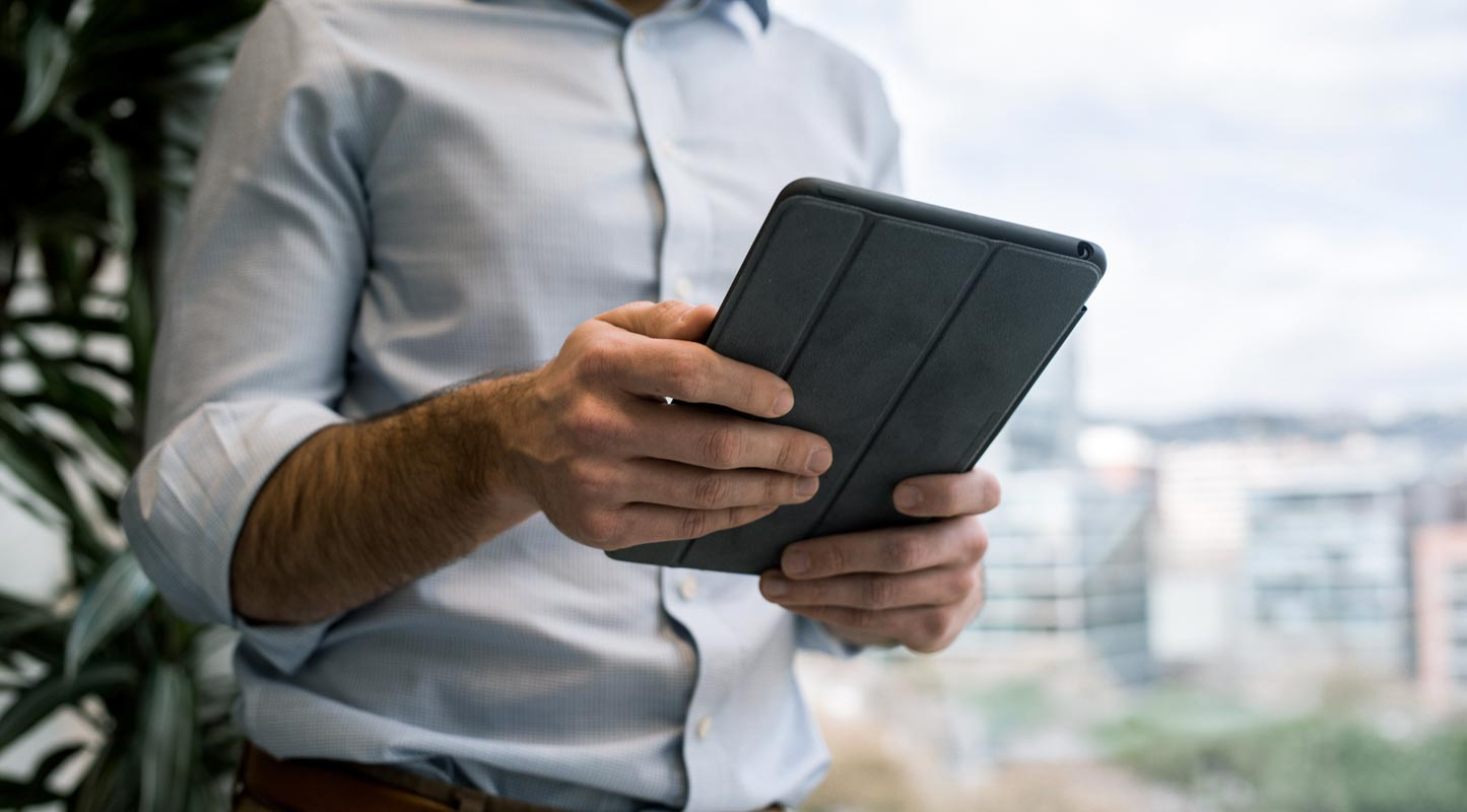 Man Using Tablet in Hand