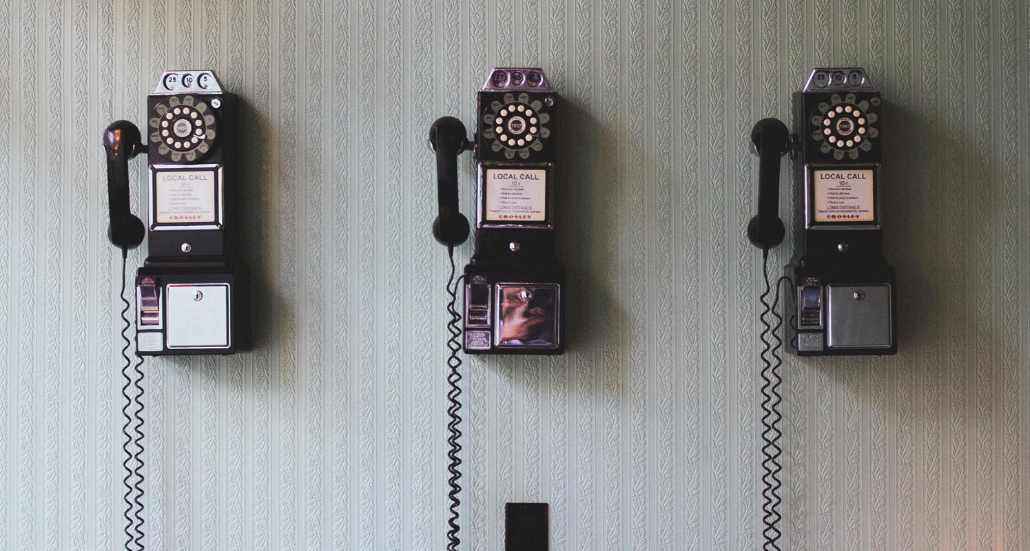 Old Dialer Phones on the Wall
