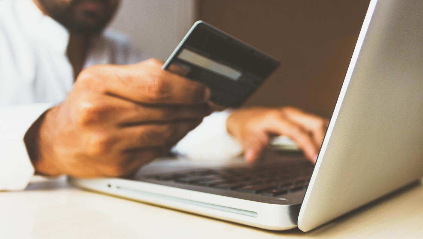 Person Purchasing Things in Online Store using Card