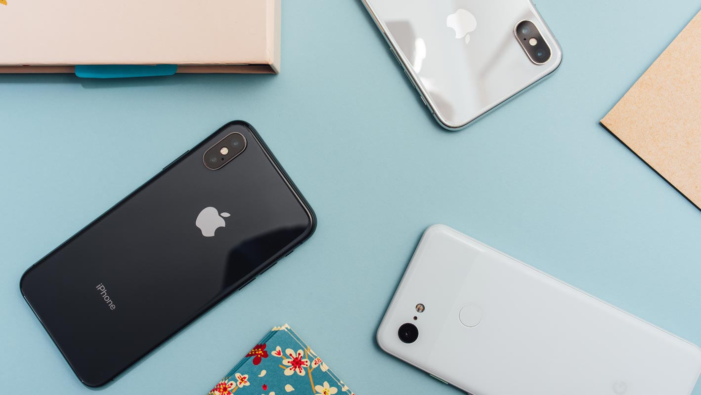 iPhone X with Pixel 3a on the table