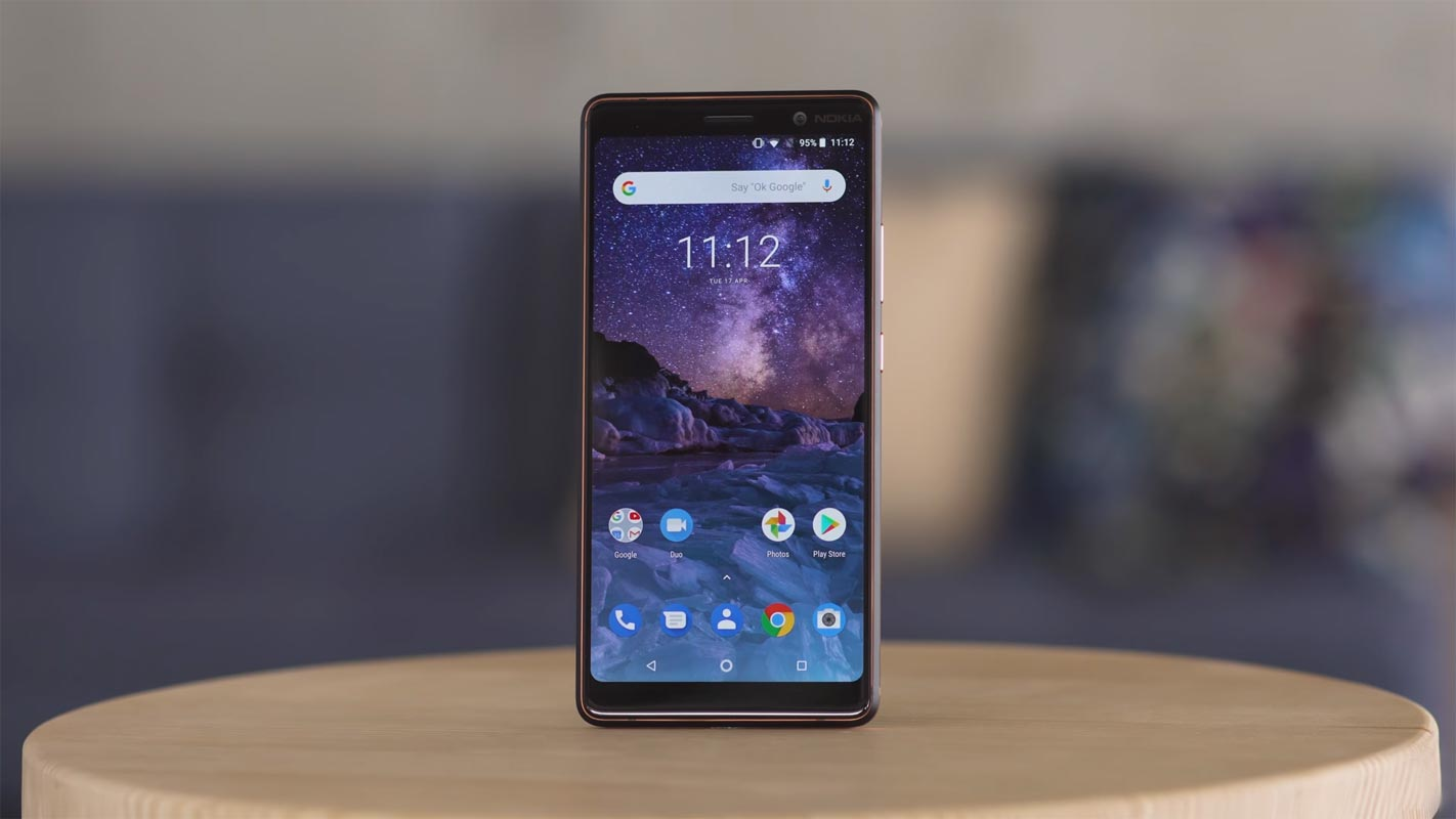 Nokia 7.1 Plus on the Wooden Table