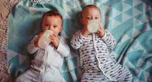 Two Babies Drinking Milk