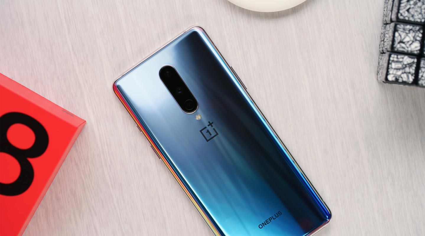OnePlus 8 on the Wooden table with D Brand Qube