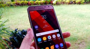 Samsung Galaxy J7 NXT with Unlocked Home screen in the hand