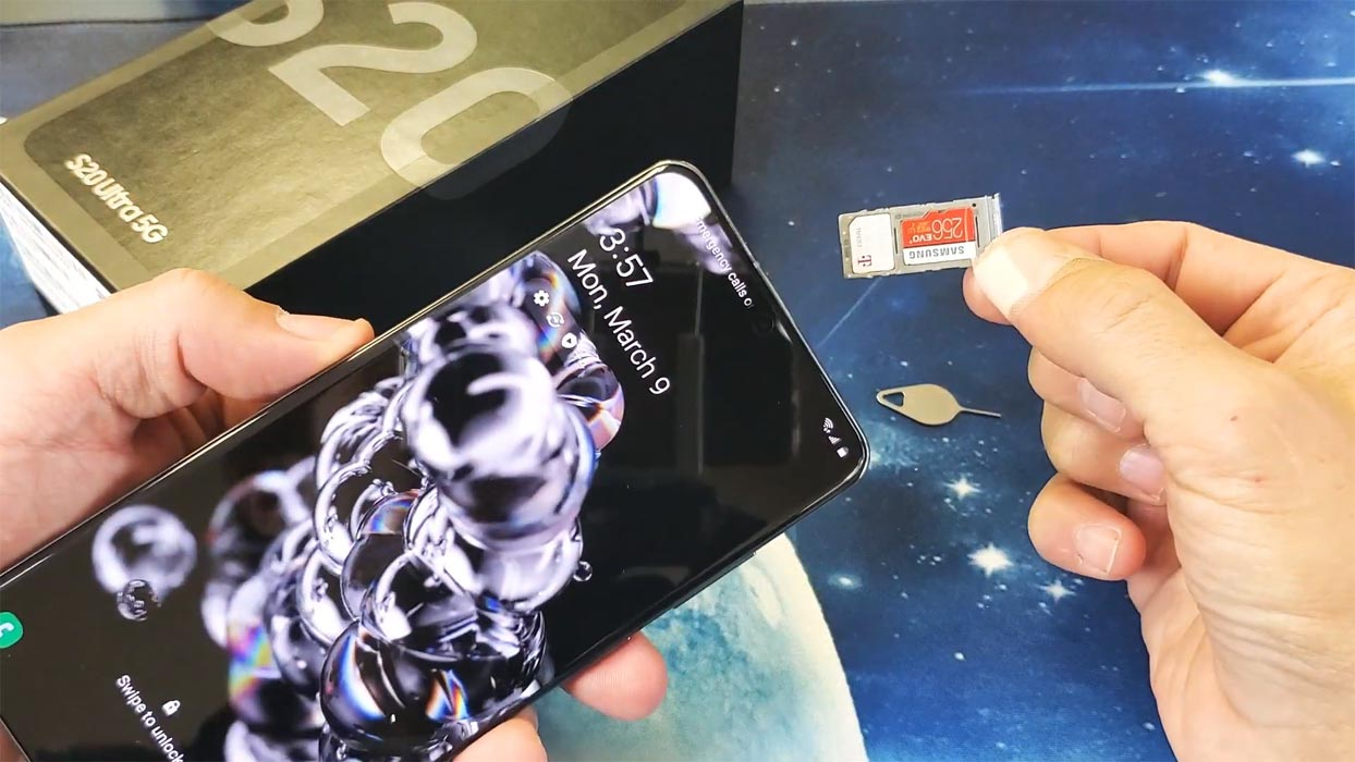 Samsung Galaxy Ultra 5G with SIM and Card tray in hand