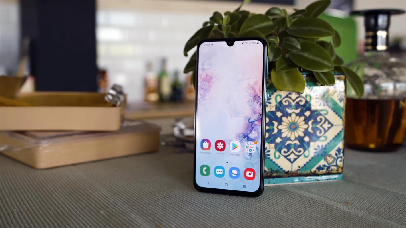 Samsung Galaxy A40 With Unlocked Home Screen on the Kitchen Table
