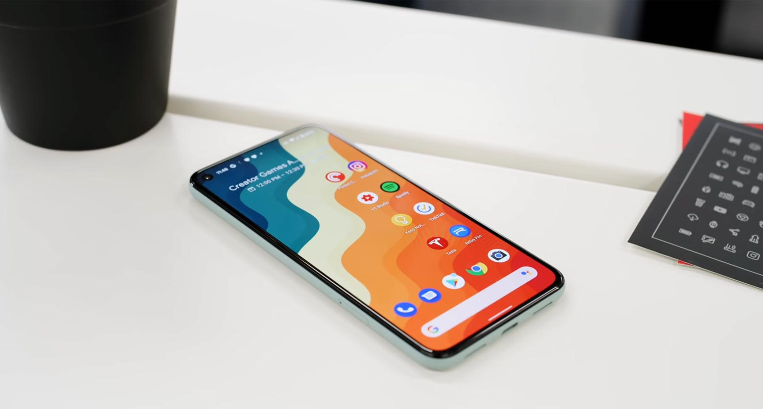 Google Pixel 5 Home screen on the table with icon sheet