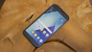 Samsung Galaxy A7 2017 Unlocked Home Screen on the Wood Piece