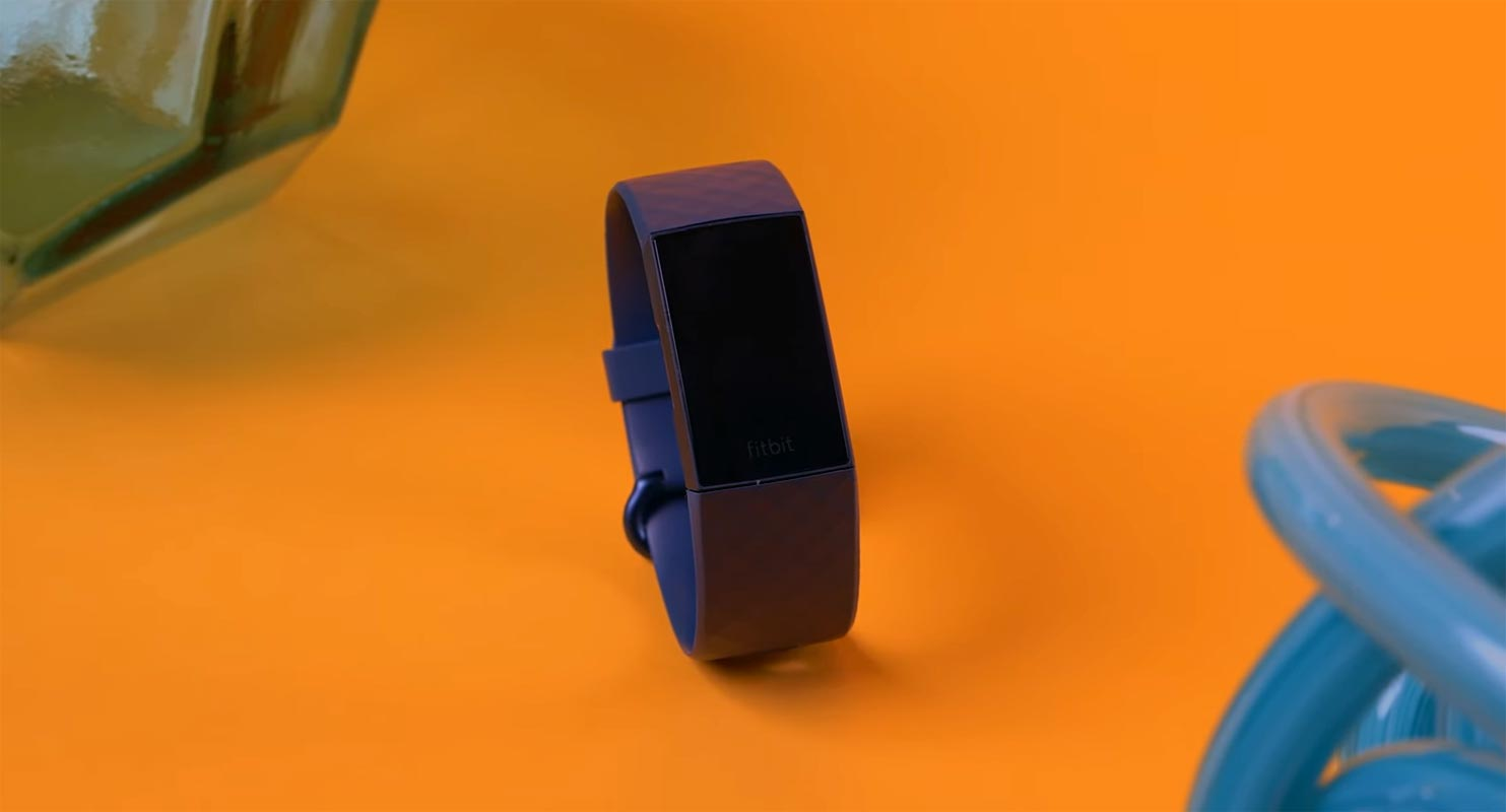 Fitbit Charge 4 on the Orange Color Table